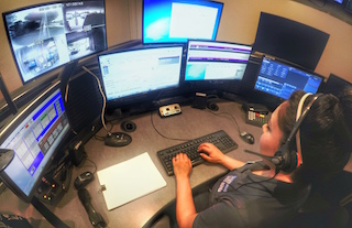 Dispatcher working at computer station
